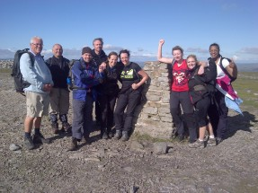 Members of the Langley team at the top of the third mountain of the Three Peaks