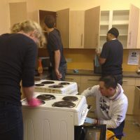 Group of Carillion staff cleaning the kitchen at one of Langleys London projects as part of Giving Tuesday 2014