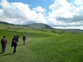 A team of 4 people walking across a section of the Yorkshire 3 Peaks in 2013