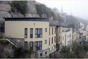The Leonard Stocks Centre, a homeless hostel in Torquay. It is a smart-looking building, with sandstone and black colouring