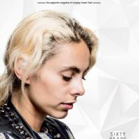 Front cover of Breakout - Langley's supporter magazine, March - May edition. A young white woman, with blond, tied up hair, is facing sideways, looking down. She looks pensive and thoughtful. The cover also states 60 years of Langley (1958-2018)