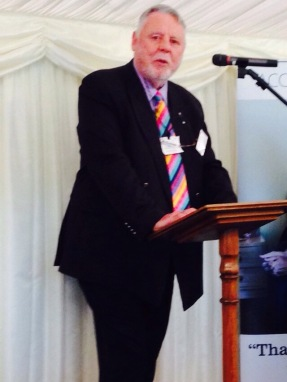 Terry Waite (man) standing at podium