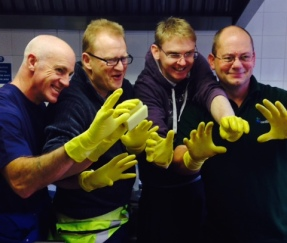 Group of Carillion staff at Langley's Coventry project in 'marigolds' (gloves) as part of cleaning for Giving Tuesday 2014