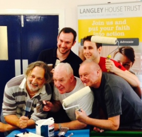 Group of Carillion staff getting ready to paint at one of Langley's projects as part of Giving Tuesday 2014