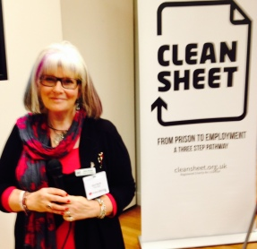 Jane Gould, founder of Clean Sheet, standing in front of a Clean Sheet pop-up banner at an event