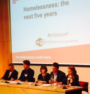 Panel of speakers sat at a table at the Crisis Homelessness Conference 2015