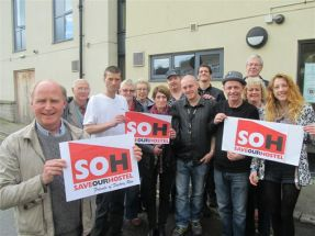 Friends of Factory Row supporters with Nick Pannell, Chair, holding up signs saying 'Save our Hostel' when the Leonard Stocks Centre was faced with closure in 2014