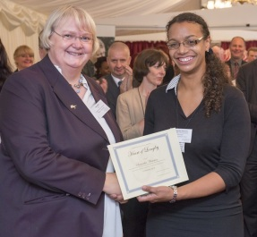 CEO Tracy Wild presenting an award to female staff member at House of Lords Annual Review launch 2015
