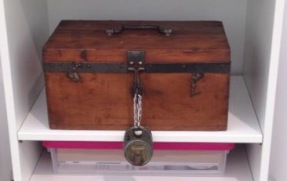 Wooden treasure box with large padlock