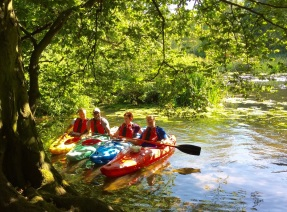 4 Langley staff in kayaks - about to start a sponsored paddle on the River Avon on a bright, sunny day