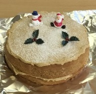 Cake entry in the Langley Bake Off 2015, Two tier cake with a santa and snowman topper and some holly leaves