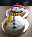 Entry into Langley Bake Off 2015 - an cake iced to look like a snowman, wearing a red hat and a yellow scarf.