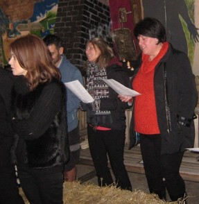 People singing at one of Langley's carol concerts - stood in a barn - Christmas 2015
