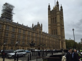 Picture showing the Houses of Parliament on a busy London day, set against the backdrop of an overcast sky