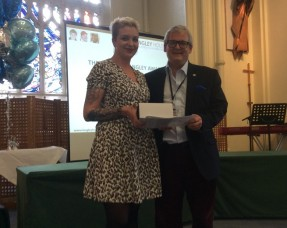 One of Langley's staff members being given an award at the Staff Conference 2016