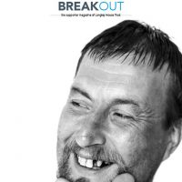 Front cover of supporter magazine, Breakout, March - May 2017. White man with a moustache and beard, holding his chin in his hands.