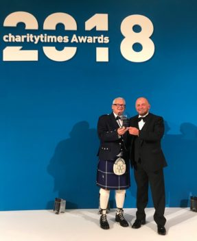David Wm. Reynolds (left) and Andrew Lerigo (right) receiving Langley's Charity of the Year Award (income over £5m) at the Charity Times Awards 2018.