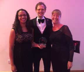 Langley staff members holding the 24Housing Awards, pictured with Mark Dolan, an English comedian who hosted the awards ceremony